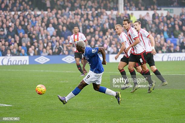 Arouna Kone of Everton shoots to score his second goal during the Barclays Premier League match between Everton and Sunderland at Goodison Park on...