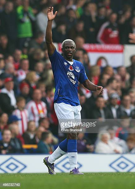 Arouna Kone of Everton waves to the crowd as he scores their second goal during the Barclays Premier League match between Everton and Sunderland at...