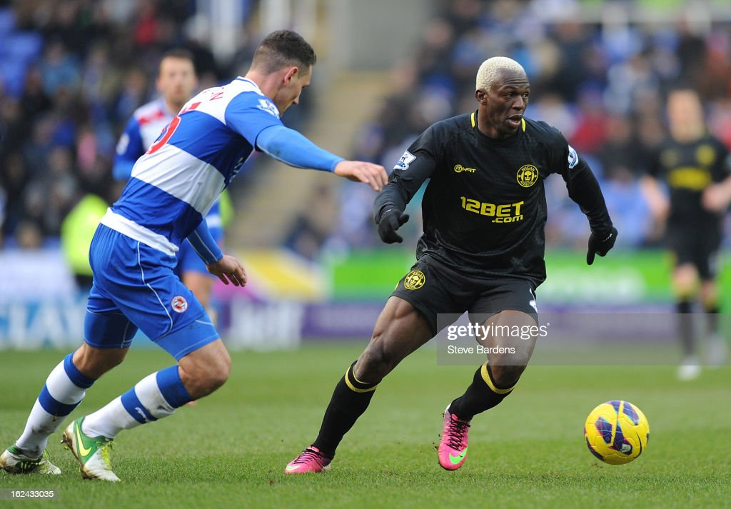 <a gi-track='captionPersonalityLinkClicked' href=/galleries/search?phrase=Arouna+Kone&family=editorial&specificpeople=550782 ng-click='$event.stopPropagation()'>Arouna Kone</a> of Wigan Athletic breaks away from Sean Morrison of Reading during the Barclays Premier League match between Reading and Wigan Athletic at Madejski Stadium on February 23, 2013 in Reading, England.