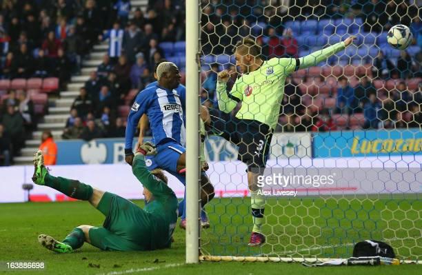 Arouna Kone of Wigan Athletic scores the winning goal during the Barclays Premier League match between Wigan Athletic and Newcastle United at the DW...