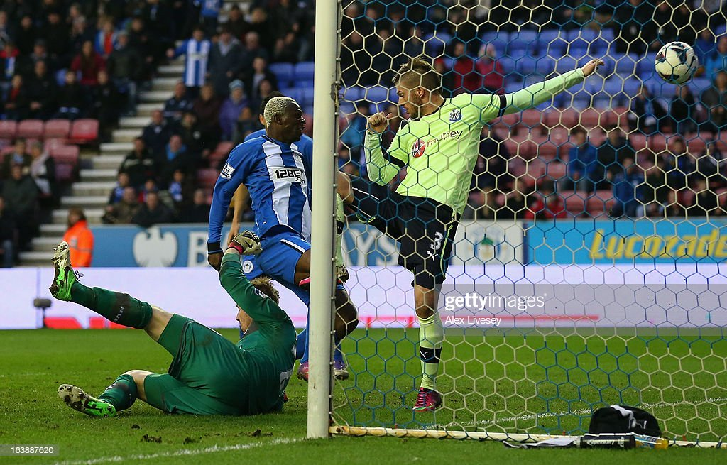 <a gi-track='captionPersonalityLinkClicked' href=/galleries/search?phrase=Arouna+Kone&family=editorial&specificpeople=550782 ng-click='$event.stopPropagation()'>Arouna Kone</a> of Wigan Athletic scores the winning goal during the Barclays Premier League match between Wigan Athletic and Newcastle United at the DW Stadium on March 17, 2013 in Wigan, England.
