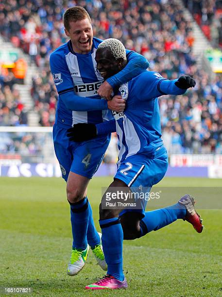 Arouna Kone of Wigan celebrates his goal with team mate James McCarthy during the Premier League match between Wigan Athletic and Norwich City at the...