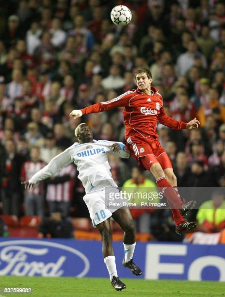 Arouna Kone PSV Eindhoven and Daniel Agger Liverpool battle for the ball