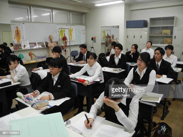 Around 20 students hear a lecture at the Japan College of Humanceremony the country's only institution to train embalmers in Hiratsuka in Kanagawa...