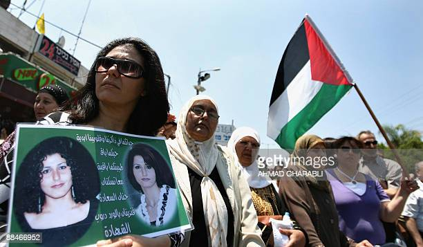 Around 250 people some holding up Palestinian flags protest in the northern Israeli town of Shfaram on June 13 2009 against the indictment of 12...