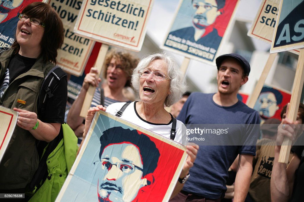 Around 50 activists protest infront of the German Chancellory in solidarity with Whistleblower Edward Snowden and his seek for asyl in various...