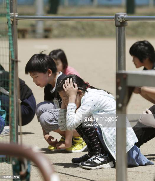 Around 550 people including children of the Sea of Japan coastal city of Sakata take part in an evacuation drill on June 9 in the wake of North...