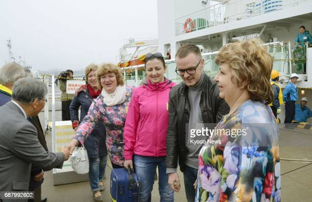 Around 60 Russians from islands known as the Northern Territories by Japan and the Southern Kuriles by Russia arrive at the Japanese port of Nemuro...