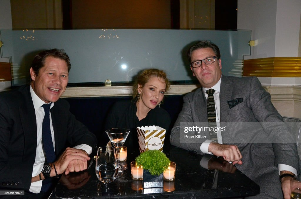 Arpad Busson, Uma Thurman, and Paul James attend the opening of the King Cole Bar And Salon at the St. Regis on November 19, 2013 in New York City.