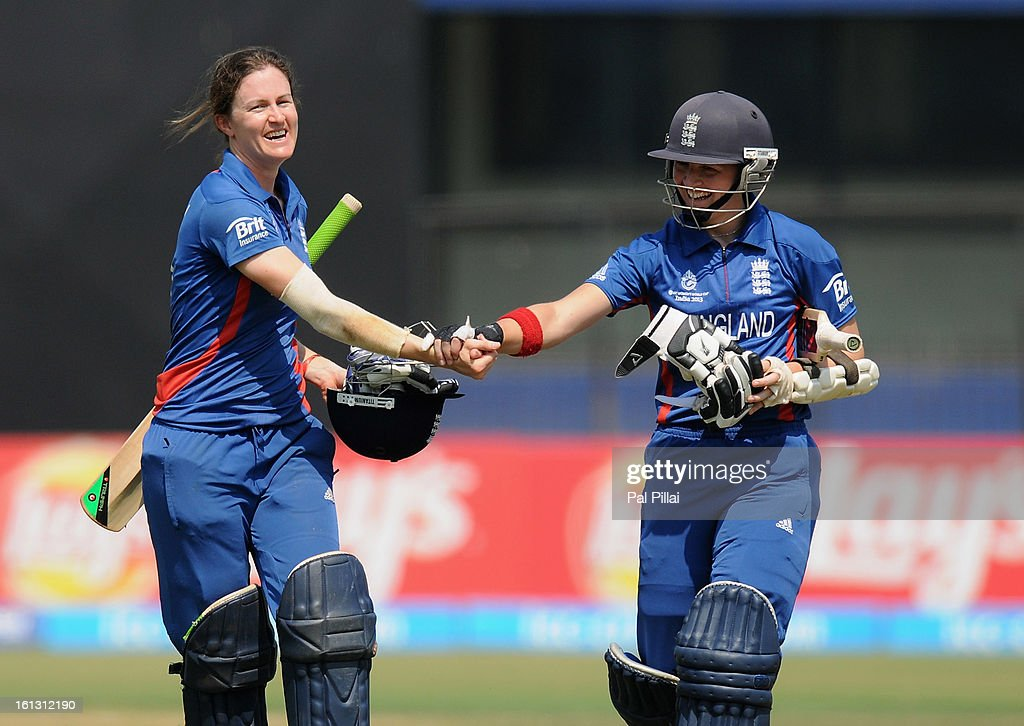 Arran Brindle and Lydia Greenway of England shake hands as they walk back after winning the Super Sixes between England and South Africa at the Barabati stadium on February 10, 2013 in Cuttack, India.