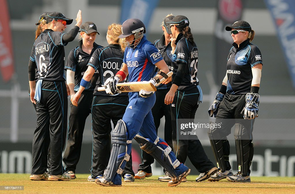 Arran Brindle of England walks back after getting out as the New Zealand team celebrates her wicket during the 3rd/4th Place Play-Off game between England and New Zealand held at the CCI (Cricket Club of India) ground on February 15, 2013 in Mumbai, India.