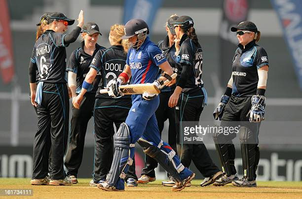 Arran Brindle of England walks back after getting out as the New Zealand team celebrates her wicket during the 3rd/4th Place PlayOff game between...
