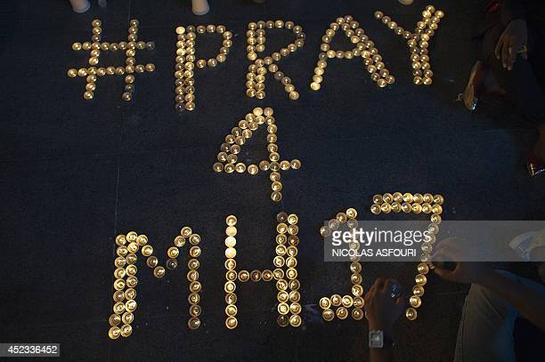 Arranged candles are pictured during a candlelight vigil for the victims of the Malaysia Airlines flight MH17 from Amsterdam to Kuala Lumpur at a...