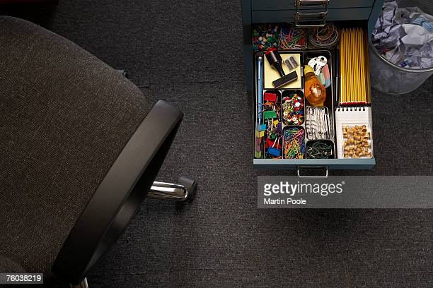 Arranged office supply in drawer of desk, elevated view