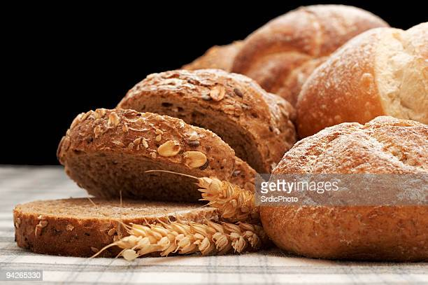 Arrangement of bread, wheat, croissant and johnnycake