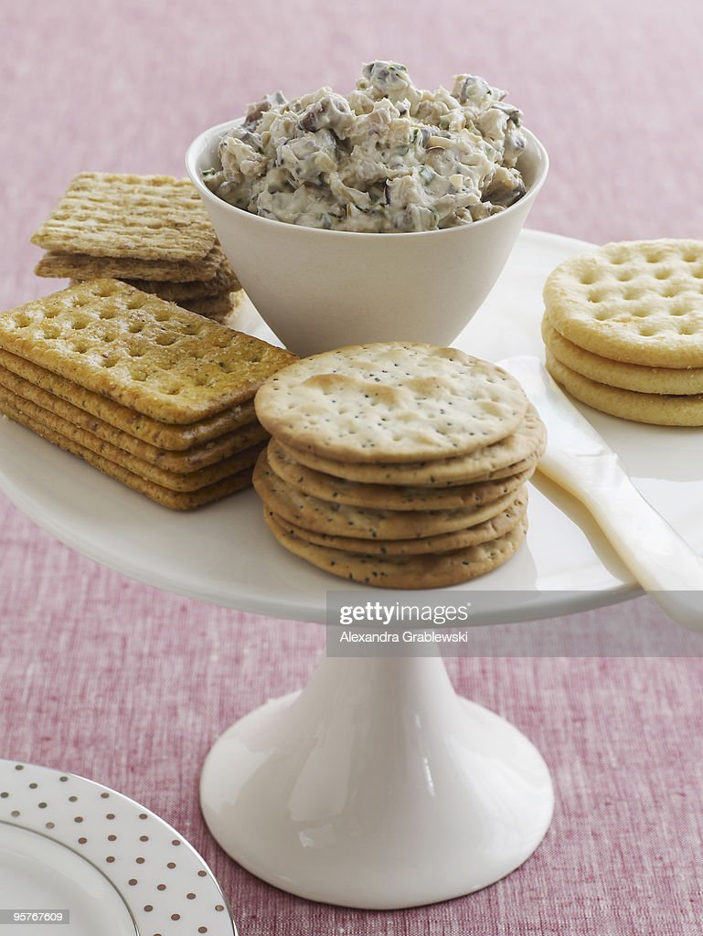 Arrangement of crackers with mushroom spread. : Stock Photo