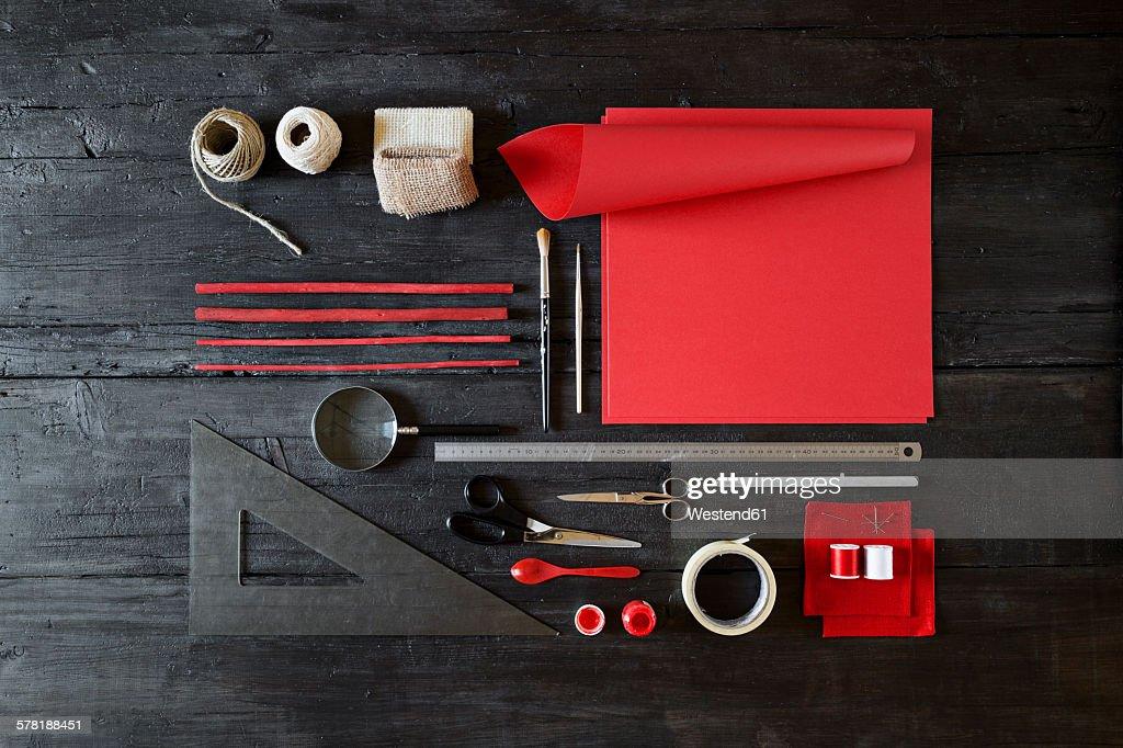Arrangement of craft materials on black wood