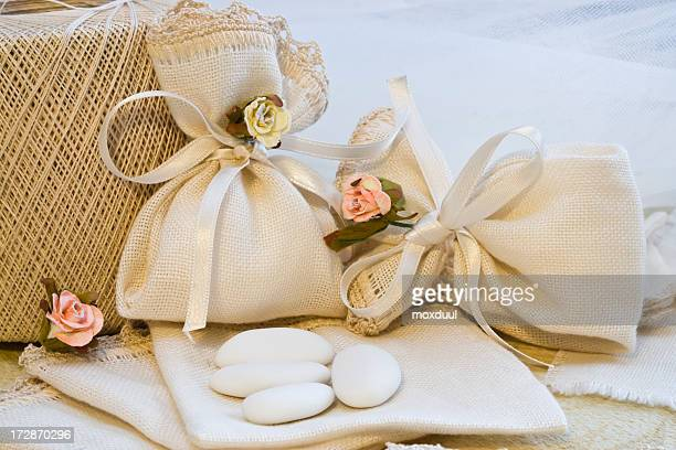 Arrangement of cream and rose colored wedding favors