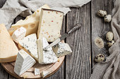 arrangement of gourmet cheese on wooden background,concept of gourmet cheeses