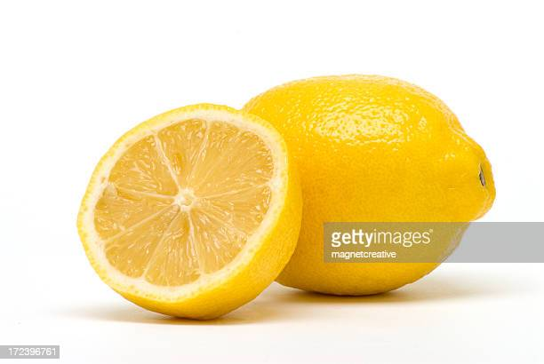 Arrangement of half lemon resting against a full lemon