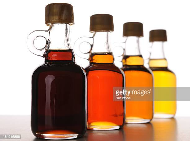 Arrangement of Maple Syrup Bottles with Various Grades