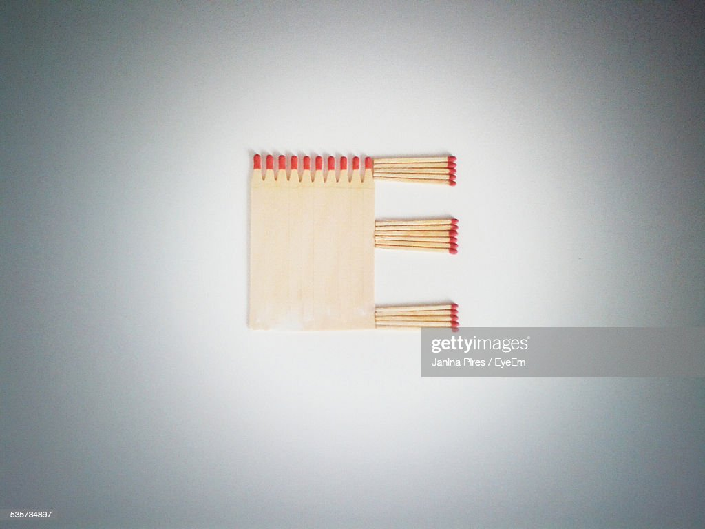 Arrangement Of Matchsticks To Form Letter E On Table