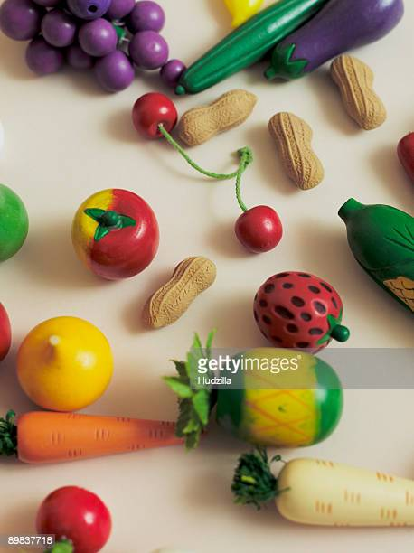 Arrangement of toy fruits and vegetables