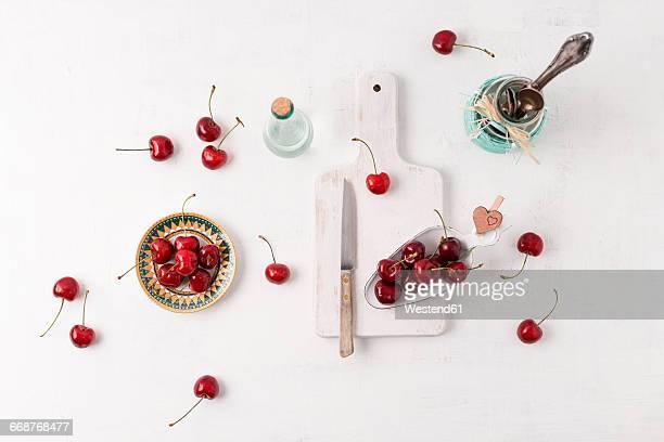 Arrangement with sweet cherries on white ground