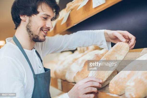 Arranging the bread shelf