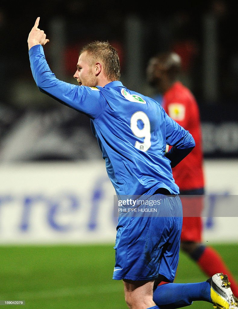 Arras' forward Despres Arnaud celebrate after scoring a goal during the French cup football match Arras vs Paris Saint-Germain, on January 6, 2013 at the Epopee Stadium in Calais, northern France.