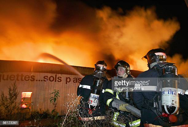 Firemen fight a blaze at a furniture warehouse late 08 November in Arras northern France A state of emergency in riotareas of France failed to...