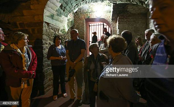 Arras France May 15 A group tours the 1000 year old limestone quarry under the main square of Arras called the Boves Currently there is a series of...