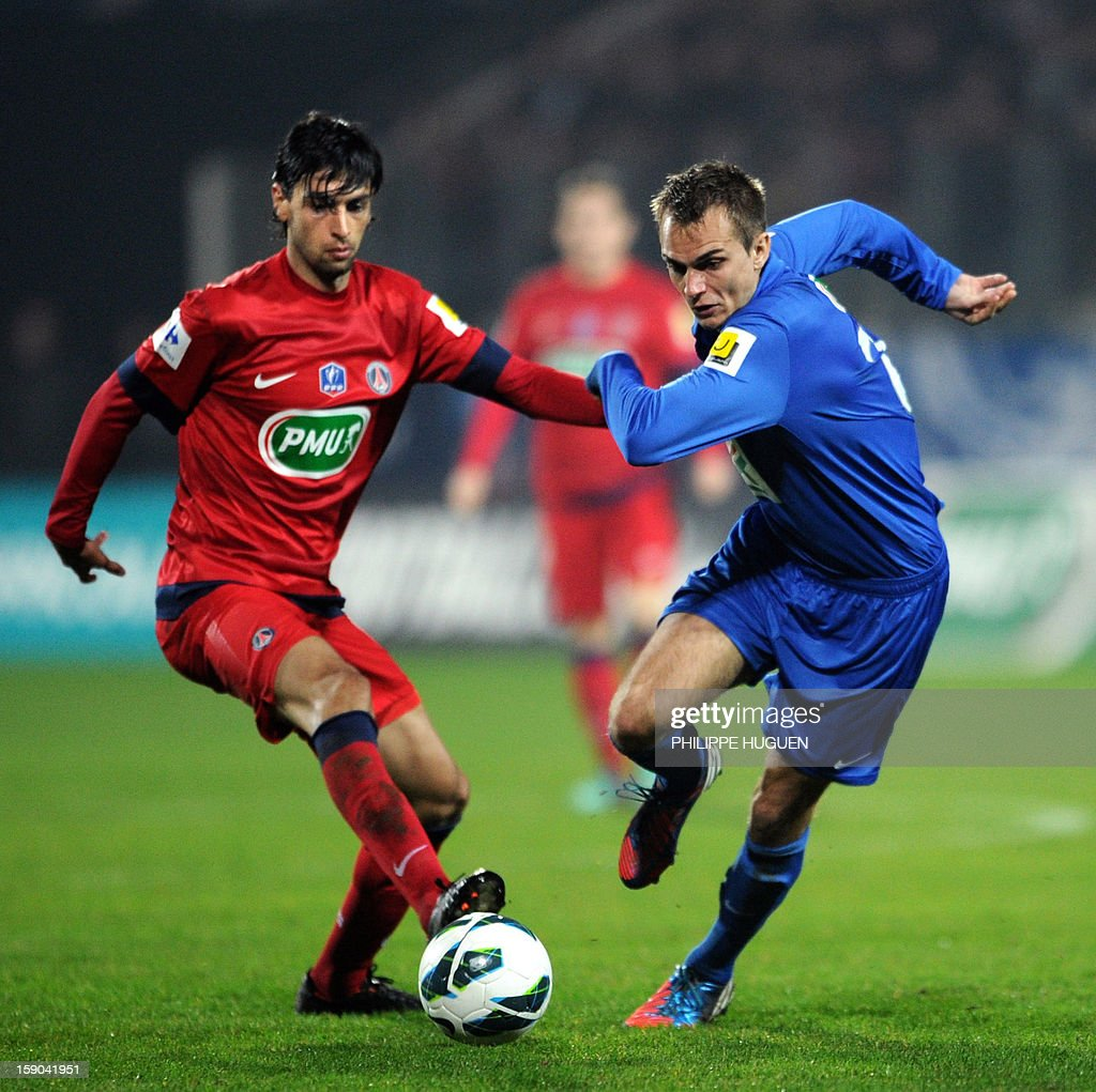 Arras' midfielder Lamiaux Valentin (R) vies with Paris Saint-Germain's Argentinian midfielder Javier Pastore during the French cup football match Arras vs Paris Saint-Germain, on January 6, 2013 at the Epopee Stadium in Calais, northern France.