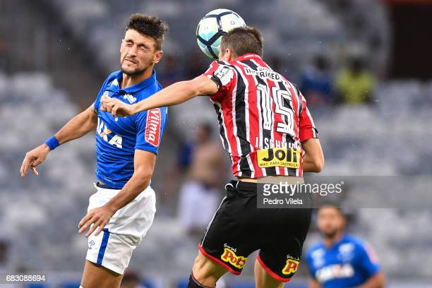 Arrascaeta of Cruzeiro and Joao Schimidt of Sao Paulo battle for the ball during a match between Cruzeiro and Sao Paulo as part of Brasileirao Series...