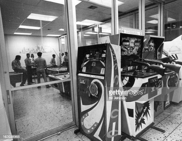 JUN 20 1974 JUN 29 1974 JUL 1 1974 Array of coinoperated rifles and machine guns foreground greets persons at Stapleton International Airport Pool...