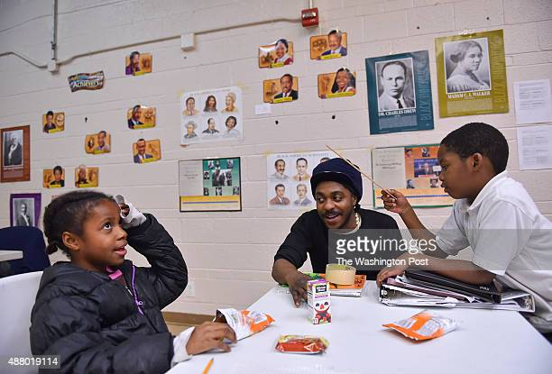 Arre Reid a staff tutor works with Angel Coley left and Devin Clark on their school work during the after school program at the KenilworthParkside...