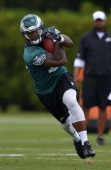 Arrelious Benn of the Philadelphia Eagles runs the ball during training camp at the NovaCare Complex on July 26 2013 in Philadelphia Pennsylvania
