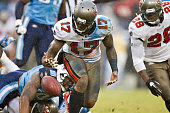 Arrelious Benn of the Tampa Bay Buccaneers fumbles during a game against the Tennessee Titans at LP Field on November 27 2011 in Nashville Tennessee...