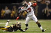 Arrelious Benn of the Tampa Bay Buccaneers gets away from Leigh Torrence of the New Orleans Saints during their game at MercedesBenz Superdome on...