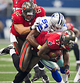 Arrelious Benn of the Tampa Bay Buccaneers is tackled by Bruce Carter of the Dallas Cowboys at Cowboys Stadium on September 23 2012 in Dallas Texas...