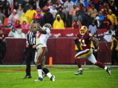 Arrelious Benn of the Tampa Bay Buccaneers makes a catch against Kareem Moore of the Washington Redskins at FedEx Field on December 12 2010 in...
