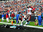 Arrelious Benn of the Tampa Bay Buccaneers makes a catch for a touchdown against Darius Butler of the Carolina Panthers at Bank of America Stadium on...
