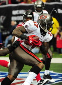 Arrelious Benn of the Tampa Bay Buccaneers makes a catch for a touchdown against the Atlanta Falcons at the Georgia Dome on November 7 2010 in...