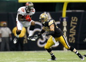 Arrelious Benn of the Tampa Bay Buccaneers pulls in this reception against Scott Shanle of the New Orleans Saints at MercedesBenz Superdome on...