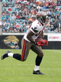 Arrelious Benn of the Tampa Bay Buccaneers runs for yardage during the game against the Jacksonville Jaguars at EverBank Field on December 11 2011 in...