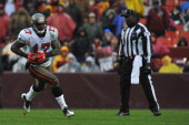 Arrelious Benn of the Tampa Bay Buccaneers runs the ball against the Washington Redskins at FedExField on December 12 2010 in Landover Maryland The...