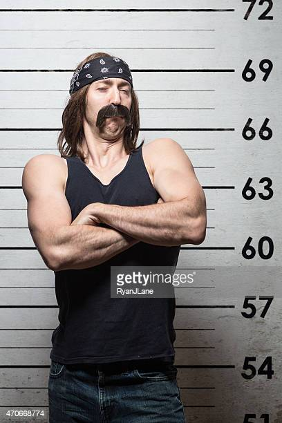 Arrested Biker Mugshot at Police Station