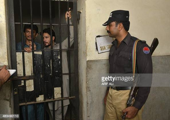 Arrested gang members of a sexual abuse scandal stand in the police lockup as they speak to the media in Hussain Khanwala village some 55 kms...
