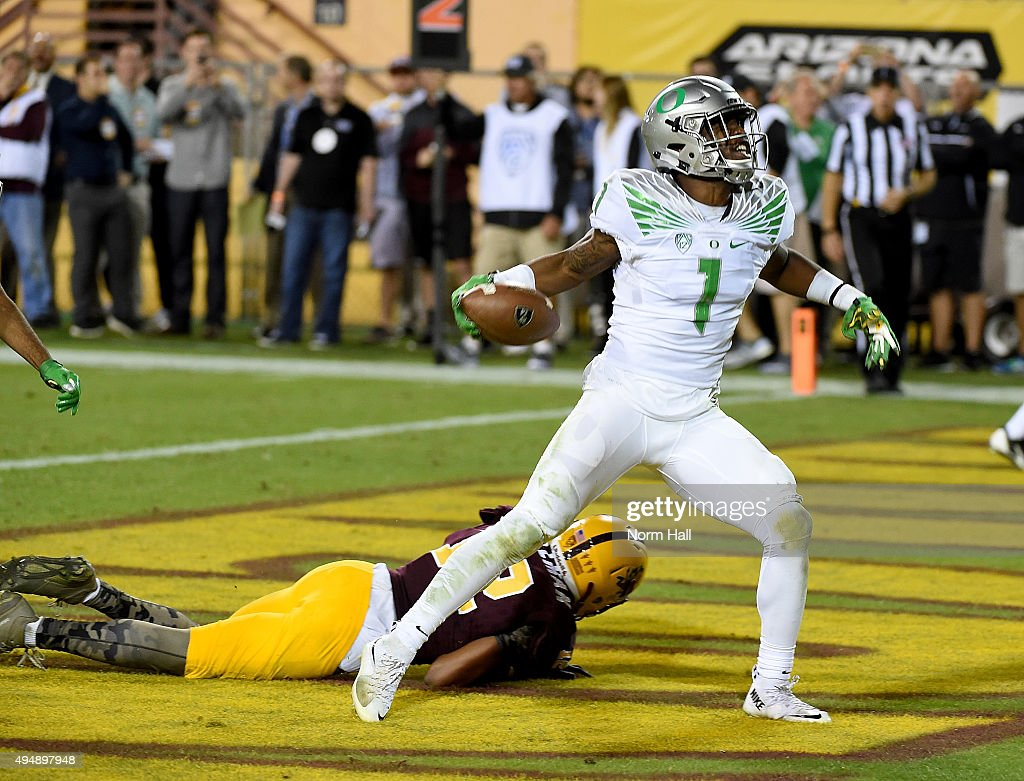 Arrion Springs of the Oregon Ducks celebrates the game winning interception during the third overtime against the Arizona State Sun Devils at Sun...