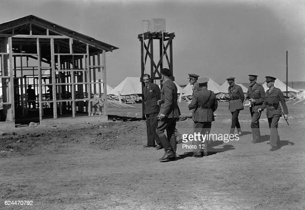 Arrival in Palestine of Mr Anthony Eden Mr Eden officers walking through Australian camp in S Palestine 1942